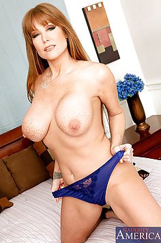 MILF Darla Crane fucks and sucks a big dick.