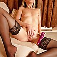 This cougar knows how to enjoy her sex toys - image